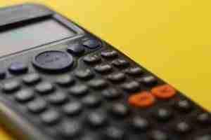 calculator in a yellow desk