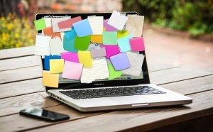 laptop with sticky notes
