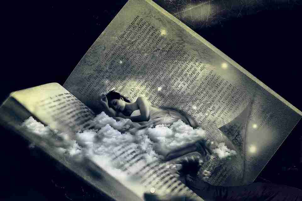 woman lying in clouds on a book