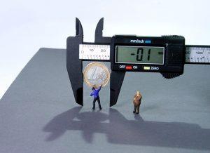 caliper with miniature figures