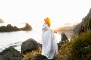 woman in dress along the coastline